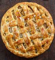round baked fruit cake with a braided top