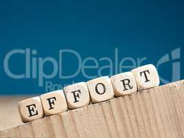 The word effort on small wooden dices
