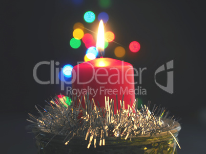 A red candle with blurred background