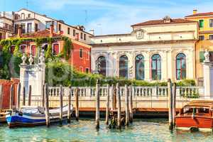 Channel of Venice with luxurious houses and boats moored, Italy