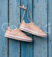 pair of beige female sports shoes