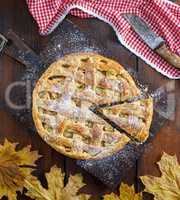 whole round apple pie on a rectangular old brown board