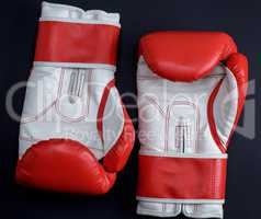 pair of red-white leather boxing gloves