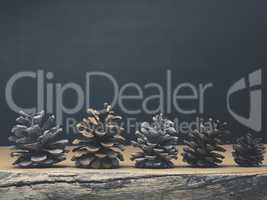 Pine cones on a rustic wooden table