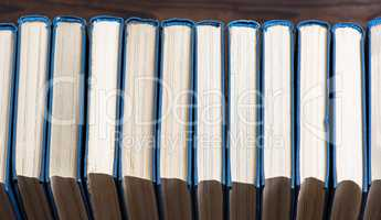 row of books with blue cover
