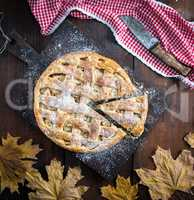 Baked whole round apple pie , wooden table, top view