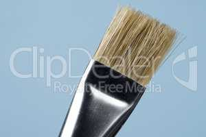 detail of brush bristles with blue background.
