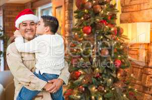 Hispanic Armed Forces Soldier Wearing Santa Hat Hugging Son