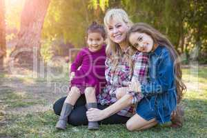 Caucasian Grandmother With Young Mixed Race Grandaughters Outdoors