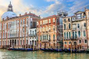 Gondolas of Venice in front of medieval palaces and the dome of