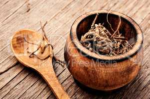 Valerian roots on wooden background