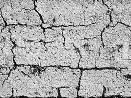 textures of old wall surface painted with white paint and covered with cracks