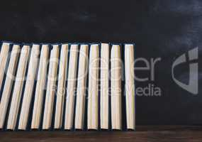 books with blue cover, black background