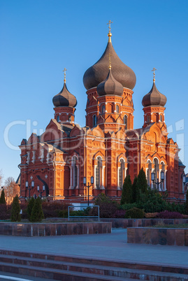 Orthodox assumption Cathedral of red brick. Winter Sunny day, blue sky on the background. Russia, Tula