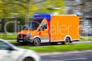 German ambulance drives to a place of employment. Rettungsdienst