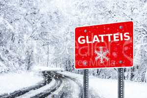 Warning traffic sign on a ice road. Glatteis is the german word for glazed frost