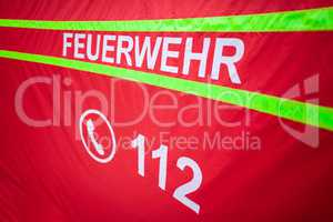German fire department logo on a tent. The german word Feuerwehr means fire department.