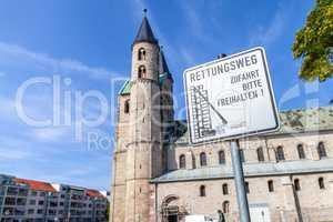German escape route sign near a church. Rettungsweg, Zufahrt freihalten means escape route, keep clear the driveway