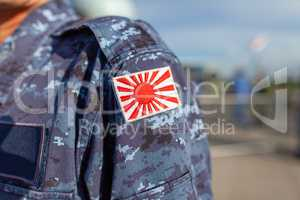 Rising Sun Flag of Japan patch on a soldier uniform