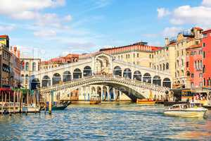 Rialto Bridge, a popular landmark of Venice, Italy, summer view