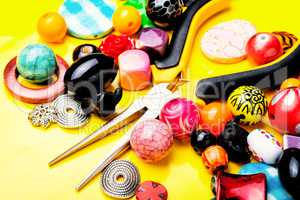 Beads on yellow background