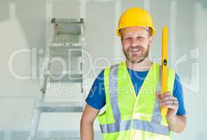 Caucasian Male Contractor With Hard Hat, Level and Safety Vest