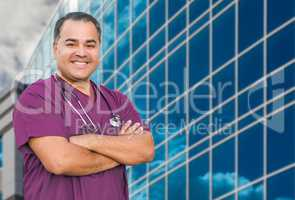 Hispanic Male Nurse In Front Of Hospital Building