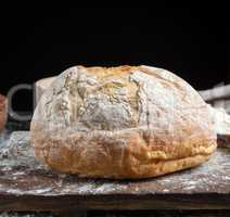 whole baked round bread made from white wheat flour