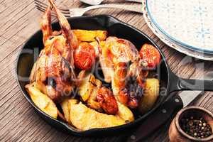 Baked whole quail with potatoes