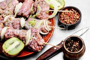 Raw beef shish kebab on skewers
