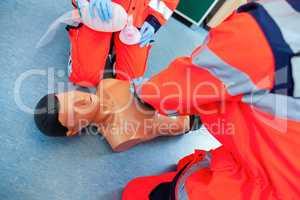German paramedic trains emergency basics on a puppet