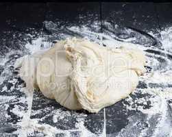 piece of white wheat flour dough