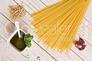 Pesto genovese and linguine pasta, pine nuts and garlic on a tab