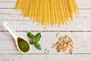 Pesto genovese sauce and linguine pasta, pine nuts and garlic on