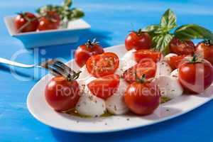 Closeup if Italian caprese with mozzarella, cherry tomatoes and