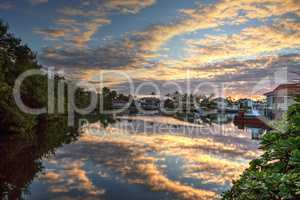 Harbor with boats at golden hour as day breaks over the North Gu