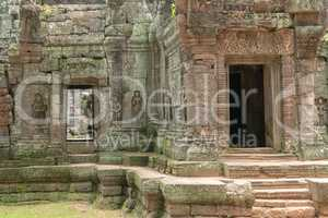 Decorated doorway and bas-reliefs at Ta Som