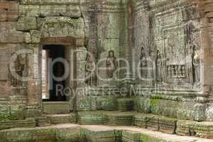 Decorated entrance and bas-reliefs in stone temple