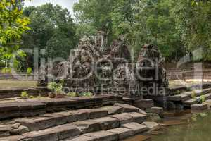 Decorative stone chamber and steps by pond