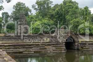 Decorative stone monuments in ponds with trees