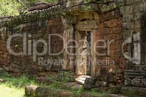 Doorway in stone wall of Banteay Kdei