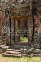 Doorway to stone temple with decorated pediment