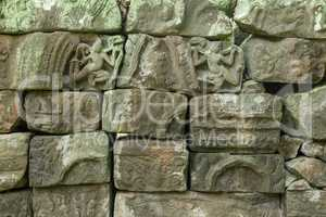Jumble of decorated stone blocks from temple