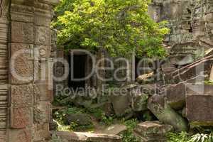 Pile of rocks by two temple doorways