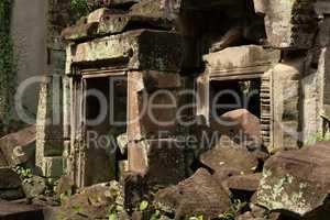 Two stone doorways blocked by fallen rocks