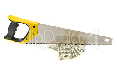 Hand sawing a bundle of US dollars. Economic Concept. Compositio