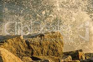 spray of the Baltic sea against a mole