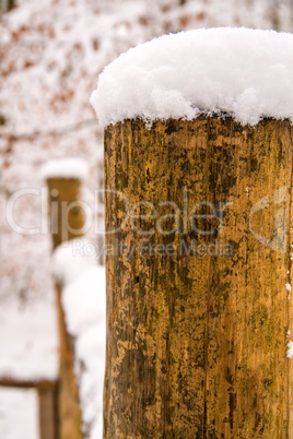snow hat on a fence mast