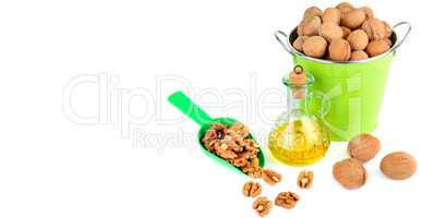 Oil of walnut and nut fruit isolated on white background. Wide p
