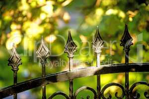 fence with cast iron ornament and view to green